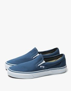 From Vans, the classic Slip-On shoe in Navy. Elasticized tongue gussets. Padded collar. Vans flag tag. Contrast stitching. EVA insert. Cotton drill lining.   • Canvas upper • Signature rubber waffle sole • Men's sizes listed