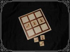 3 en raya, en madera pirograbado tanto la base como las piezas con dibujos de gatos y raspas...