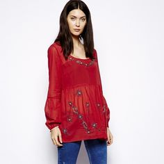 Free People red tunic A red, long sleeve glowy tunic from Free People! Very cute, has lovely beaded flowers. Says XS but fits a little larger. 100% cotton Free People Tops Tunics