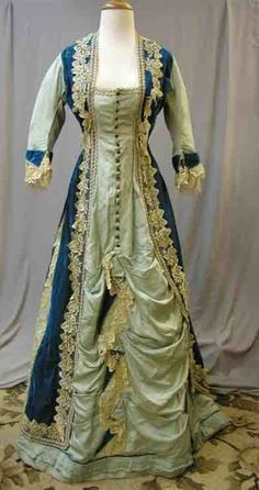 Blue, Natural Form era bustle dress. Pale blue with darker blue/teal accents and ecru lace.