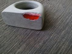 Love this idea for resin --> Concrete ring with exposed orange recycled glass.--Absolutely amazing piece!!