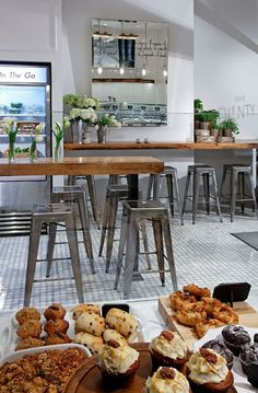 Restaurant Hospitality Design Inspiration: Cafe Plenty Looks like this is a mirror. It does a fantastic job of expaning the space! Restaurant Hotel, Restaurant Design, Cafe Interior Design, Cafe Design, Store Design, European Cafe, Design Café, Design Ideas, Cafe Bistro