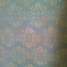 Beautiful wall texture - it's just a stencil with drywall mud and then sealed!!
