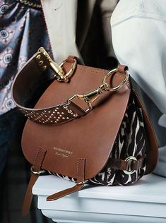 74e358ce946d The Bridle Bag from the Burberry September runway collection. An equestrian  style leather satchel featuring metallic studs and clasps.