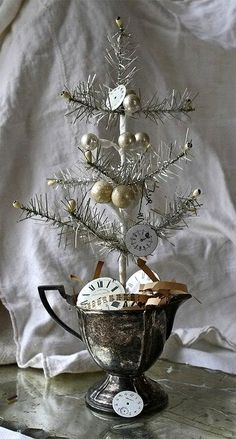 small tinsel tree in old silver pitcher Dollar store animals, glittered up for ornaments or decorations! painted pumpkin wineglasses into candleholders! hugs, Karen