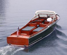 Yes please! Chris craft boat out on the lake!