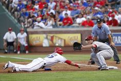 ARLINGTON, TX - JUNE 15:  Leonys Martin #27 of the Texas Rangers dives back to beat the tag by Brett Wallace #29 of the Houston Astros at Rangers Ballpark in Arlington on June 15, 2012 in Arlington, Texas. (Photo by Rick Yeatts/Getty Images) Rangers game 65, Astros game 64