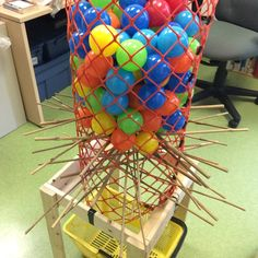 Giant Kerplunk game ready to go for tomorrow's Wacky Wednesday program - Life-Size Boardgames! Amazing what you can make from a piece of snow fence, a few 1x2's and bamboo garden stakes.