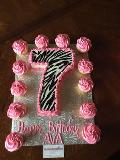 Chocolate Number 7 Cake With Zebra Print Fondant Pipes Hot Pink Icing Vanilla Cupcakes Topped Jumbo Rosettes Year Old Birthday