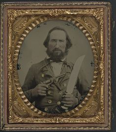 [Unidentified soldier in Confederate uniform with large Bowie knife and revolver] (LOC) | Flickr - Photo Sharing!
