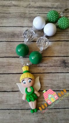 Check out this item in my Etsy shop https://www.etsy.com/listing/235841987/tinkerbell-inspired-necklace-girls