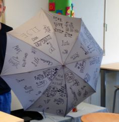 An umbrella with all the names of the kids on it. #gifts