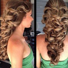 Gorgeous dirty blonde spirals/ pulled back in elegant ponytail