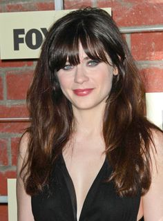 The long, tousled loose waves on Zooey Deschanel's Medium Brown hair give just the right amount of glamorous volume. Get your own most flattering hair color right at home here: www.eSalon.com