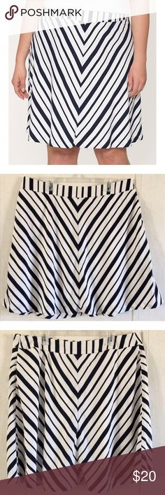 "Lane Bryant Chevron Striped Skirt Good condition. One spot under the waistband where the outer layer has been sewn back together. Really nice Lane Bryant ""Charmeuse Flippy"" skirt. White with a dark navy blue chevron stripe pattern. Fully lined inside. Zipper and hook closure up one side. Size 18. All offers welcome Lane Bryant Skirts A-Line or Full"