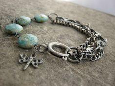 Evan.....  Multi Strand Antiqued Metal Chrysocolla gemstone dragonfly charm Bracelet. $26.00, via Etsy.