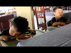 Babies falling asleep while eating spaghetti.     Ohh this is so cute. Look at the baby on the right; he's still eating!