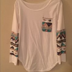 Size M white shirt with pocket and arm detail Fits great, white with turquoise, tan, white, black, and gold beading on the arms and the pocket. Scoop neck. Tops Tees - Long Sleeve