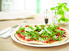Rucola    Our pizza is baked in the stone oven with only tomato sauce and mozzarella, and then topped with spicy rocket lettuce/arugula and Italian hard cheese.