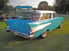 1957 Chevy Nomad. My Daddy's is blush pink. I have many wonderful memories with my family in this car, including my wedding!