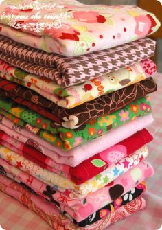 SUPER cute/innovative cloth-diaper-turned-burp-cloth idea!  Hope, look out!  You're getting inundated with these!  ;-)