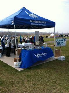 Islamic Relief USA booth with custom canopy and personalized table cover at #WalkForWater #IRUSA #IslamicRelief