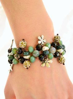 Beaded bracelet with beautiful antique silver charms- flowers, pomegranates, starfishes by IndyWeender on Etsy