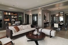 Polished wood, touches of crystal, leather, and gilded furnishings suggest real style. This space doesn't just look beautiful - it feels indulgent. Artwork fills the space, lending color.