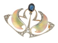 "Art Nouveau Diamond Enamel Brooch, counterbalancing the ""asymmetry"" is a pendant drop featuring an oval faceted sapphire of .35 carats set in a gold bezel."