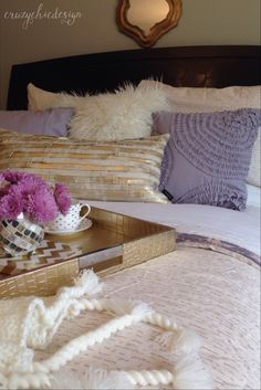 Create a glamorous bed by using metallics, soft and fluffy pillows and a warm sweater knit throw.  You'll never want to get out of bed.  Sponsored by HomeGoods.