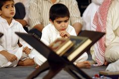 Jul 14 - Lailat al Qadr (Muslim) Muslim boys pray at the Grand Mosque in Kuwait City early on the night of 'Lailat al-Qadr' which marks the revelation of the Koran, Islam's holy book, to the Prophet Mohammed through the archangel Gabriel during the fasting month of Ramadan.