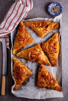Leftover Bolognese has never tasted this good. Crispy pastry, gooey cheese and rich bolognese makes these hand pies simply delicious. simply-delicious.food.com