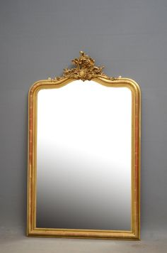 century gilt wall mirror, having original, bevelled edge mirror in cushion moulded frame with floral cresting to centre. This antique mirror retains its original gilt, glass and backboard. Antique Mirrors, Ornate Mirror, Beveled Edge Mirror, French Mirror, French Style, Polished Brass, French Antiques, Bedroom, Gallery