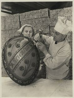 A giant Easter egg being elaborately decorated in the Rowtree's factory in 1930
