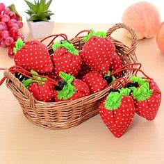 A reusable shopping bag that folds up to look like a strawberry.   27 Products That Are Almost Too Clever To Use