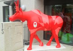 Beautiful moose as mascot for the Canadian Olympic team in front of their Olympic Village accommodations.