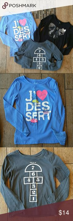 BUNDLE LONG SLEEVE TEES 3 girls long sleeve tees Blue I ❤ dessert is - GAPKIDS Gray hopscotch - GAPKIDS Black is has cinched sleeves, silver painted bow, Meant to look faded - CHILDREN'S PLACE No rips, stains, pilling or fading Smoke free home GAP KIDS & CHILDREN'S PLACE Shirts & Tops Tees - Long Sleeve