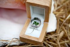 Wedding rings and a 4 leaf clover for good luck #weddingrings