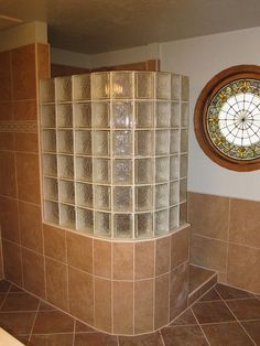 Icescapes curved glass block wall on a tiled half wall