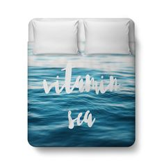 """Beach therapy for your bedroom settings, this ocean inspired duvet cover  throw features surreal blue sea throughout! Adorned with the words """"Vitamin  Sea"""" in a stylish typography font design across, this beach bohemian chic  bedroom accent makes for surf stylish addition to your sleeping quarters,  and comes available in Twin, Full, Queen and King size!   *Available in Twin, Full, Queen or King Size"""