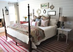 AFTER PHOTO of master bedroom in a 1970's ranch!  1x6 boards on wall were added with a nickel for spacing between, then whitewashed for farmhouse look.