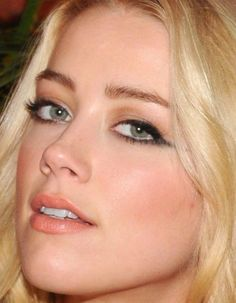amber heard dramatic winged liner peach lips
