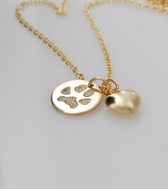 Keep your beloved pets paw print close to your heart... A name can be engraved on the back of the pendant for no additional cost. ** this can be made in sterling silver at your request at checkout. • All 14k yellow gold filled ~ not gold plated • Disc diameter: Various diameters available (see last image for size reference guide) • 14k gold filled puffed heart charm included (pictured with 1/2 pendant) • Gift boxed • Various chain lengths are available in a drop-down box during checkout   I…