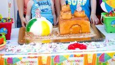 Beach ball and sand castle cake