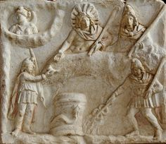 Mithras (top right) having a banquet with the sun-god (top centre, Sol or Helios) - Moon-Goddess (top left, Luna or Selene) sulking behind clouds Mithras banquet - Paris Louvre This (reverse) face B of the monument depicts a banquet scene. In the middle, a bull's hide, of which the head and one hindleg are visible. Sol and Mithras recline on it side by side. Mithras holds a torch in his left hand and extends his right hand behind Sol. Sol is dressed only in a cape, fastened on his right…