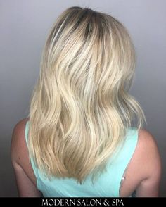 Blonde hair by Kirby Stanley at Modern Salon & Spa in Charlotte, NC.
