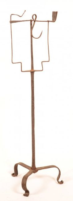 "18th Century Wrought Iron Combination Splint Candlestand. Swivel mounting with iron rod pedestal and tripod base with scrolled feet. 31-3/4""h."
