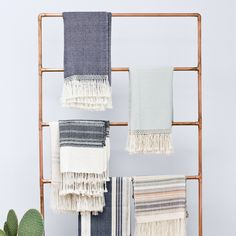 blanket display rack out of copper pipes // Love all the handwoven throws from The Citizenry