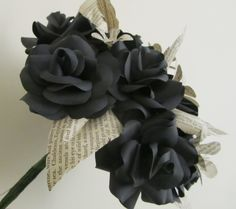 Handmade black paper roses with book paper leaves and small flowers with grey pearls.