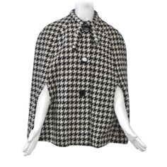 1960s Black/White Houndstooth Cape | From a collection of rare vintage jackets at http://www.1stdibs.com/fashion/clothing/jackets/